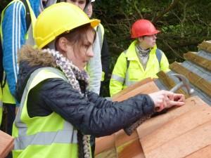 Volunteer student architect, Natalia Krysiak trying her hand Rosemary tiling