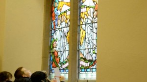 Young pupils admire historic stained glass windows
