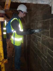 Student – Raking out stonework joints Guildhall – Stonework Workshop