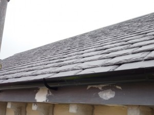 Re-roofed in natural slate and cast iron rainwater goods reinstated