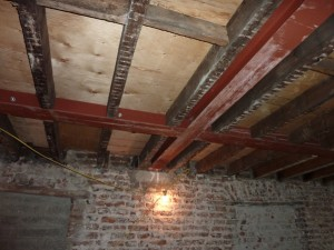 Preserving original beams whilst adding new steel structural support within depth of original floor